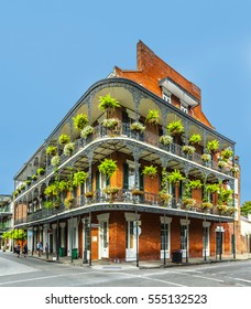 NEW ORLEANS, USA - JULY 16, 2013: people visit historic building in the French Quarter in New Orleans, USA. Tourism provides a large source of revenue after the 2005 devastation of Hurricane Katrina.