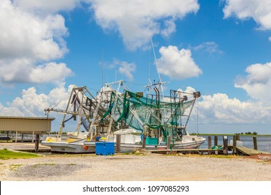 NEW ORLEANS, USA - JULY 17, 2013: fishing boat with net anchors at Marquez canal in New Orleans.