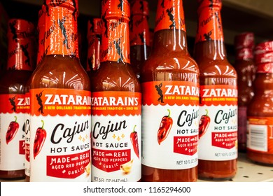 New Orleans, USA - Nov 27, 2017: The famous Zatarain's Cajun Hot Sauce in two different sizes on the shelf at Winn-Dixie Grocery Store. A well known product.