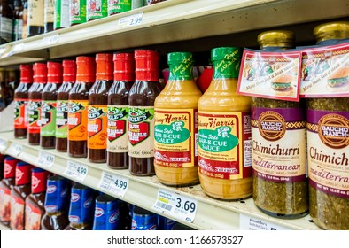 New Orleans, USA - Nov 27, 2017: Assortment of sauces in glass bottles on the shelf at Winn-Dixie Grocery Store. Caters to all kinds of food preparation needs.