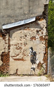 """NEW ORLEANS/USA -  October 15, 2012: """"Rat and Girl"""" -  graffit  englishi artist Banksy on the destroyed house Hurricane Katrina in New Orlean"""