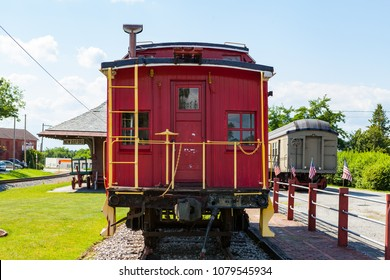New Oxford, PA, USA - June 2, 2012:  A red Pennsylvania caboose on display at the New Oxford Train Station, which now serves as a museum.