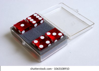 A new pack of throwing dice are opened and ready for playing.