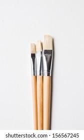 new paint brushes isolated on white, three size