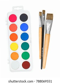 "New palette of watercolour with several paint brushes isolated on the white background with no shadow reflection. Art palette with ""aquarellum atramento""  ink and brushes. Aquarelle paints color palet"