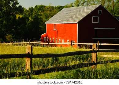 New Paltz, NY, USA June 1, 2008 A red barn sits quietly in a pasture in New Paltz, New York.  The area has a rich history of agriculture, a lifestyle that remains to this day