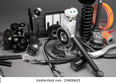 New parts for motor vehicles on a gray background closeup. Large depth of field