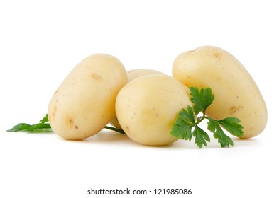 New potatoes and green parsley isolated on white background close up.