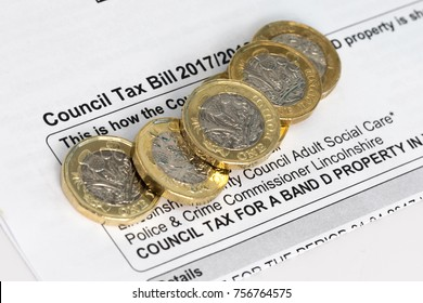 New pound coins on a council tax bill