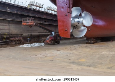 """The new propeller mounted on a refurbished ship. The inscription on the dock reads: """"welding waste storage locations""""."""