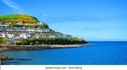New Quay  - 'Cei Newydd', picturesque houses, pubs and restaurants cling to the hills rising above the blue waters of Cardigan Bay - West Wales coast holiday resort for sailing, fishing, water sports