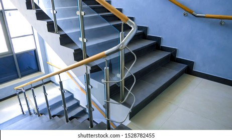 New railing made of stainless steel, glass and wood. Fall Protection. modern design of handrail and staircase