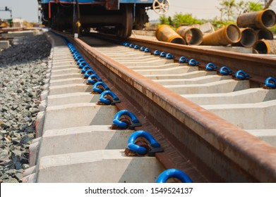 New railroad tracks with concrete railway sleepers and clip.Steel railway for trains.Train Track Bar hold E-Clip /Clip,iron material on the cement chock.