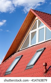 New red metal roof with attic windows (skylights) and Ventilation pipe for heat control
