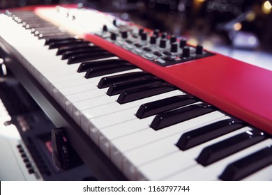 new red synthesizer. piano keys close-up. electronic musical instrument. professional DJ equipment