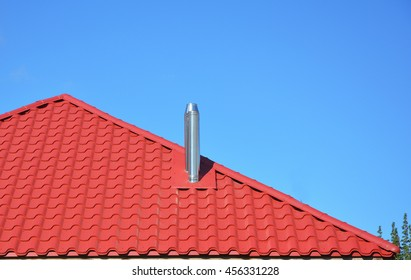 New red tiled roof with metal chimney house roofing construction exterior.