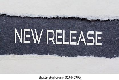 NEW RELEASE word under torn black paper.