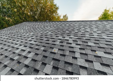 new renovated roof covered with shingles flat polymeric roof-tiles