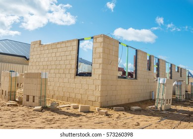 New residential  brick house construction against a blue sky.Construction site view