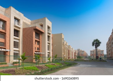 New residential building complex being built at Rajarhat New Town area of Kolkata, West Bengal, India. Kolkata is one of the fastest growing city in eastern region of India. Blue sky background.