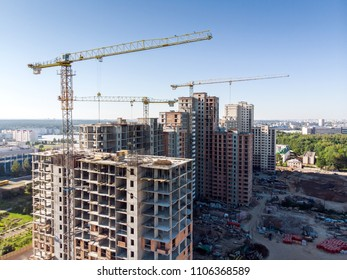 new residential building under construction against blue sky. aerial view