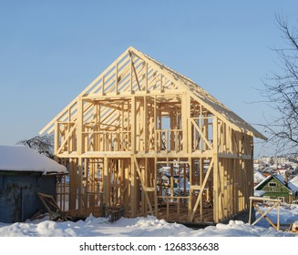 New residential construction home framing. Wooden construction, winter time, Russia.