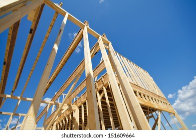 New residential construction home framing against blue sky