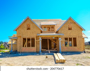 New residential home under construction, framing. North America.