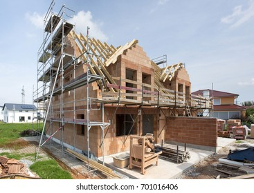 new residential house in construction with bricks and wooden planks