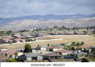 New residential housing developments in California's San Joaquin Valley are pushing against the foothills of the Sierra Nevada Range