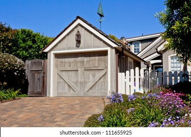A new residential single-car garage with classic Z-brace sectional door.