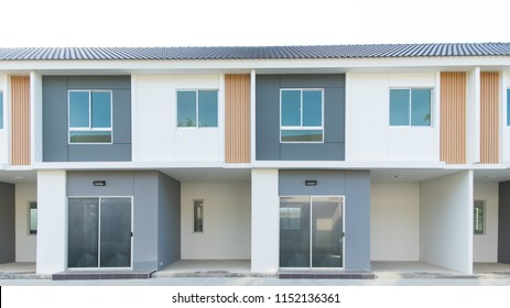 New Residential Town Home Housing Estate Modern buildings with tree.
