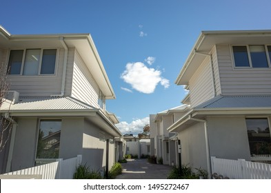 New residential townhouses in Melbourne's suburb. VIC Australia. Common walkway between homes. Townhouses in Australia are connected to one another in a row, and are usually two or three stories tall.