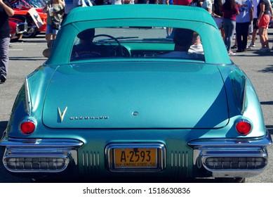 New Rochelle, NY - September 29, 2019. A 1958 Cadillac Eldorado convertible pulling into the car show at Glen Island Park.