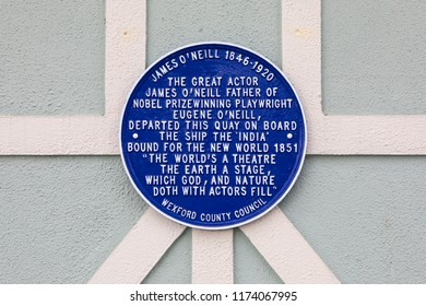 New Ross, Republic of Ireland - August 14th 2018: A blue plaque detailing where the actor James O'Neill departed from the Quay in New Ross bound for the New World in 1851.