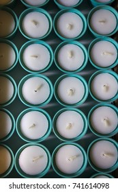 A lot of new round mint color candles. Top view