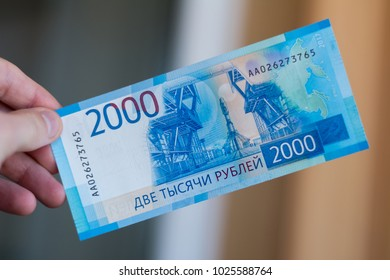 New russian bank notes with Vladivostok images on it. 2000 rubles denomination in man's hand.
