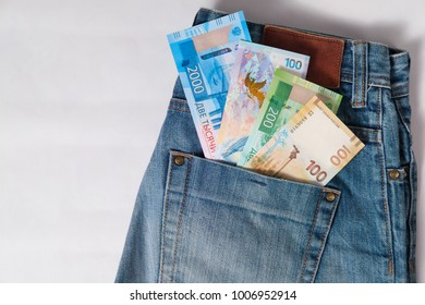 new Russian money banknotes with a dollar bill in jeans pocket