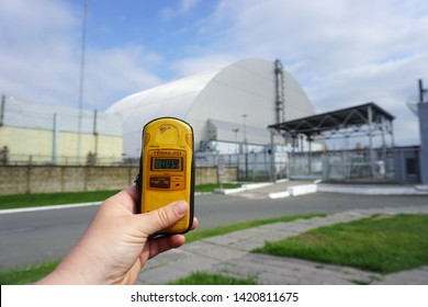 The New Safe Confinement over the remains of reactor 4 and the old sarcophagus at Chernobyl nuclear power plant. Chernobyl, Ukraine, 31.05.2019