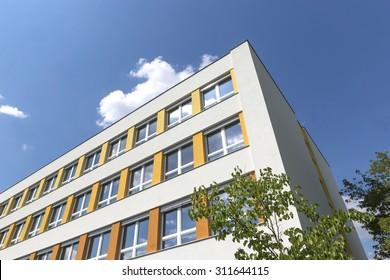 A new school building blue sky