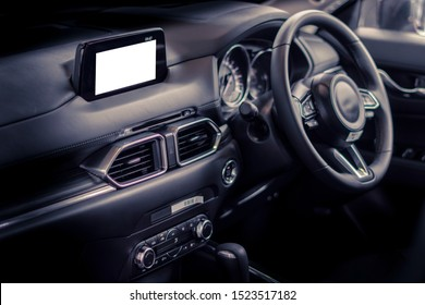 New screen technology in luxury cars. car inside blank touch screen audio display conect movie or phone call with copy space for text or map digital. used for advertising background