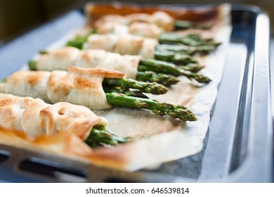 New season for fresh asparagus has just started, roasted green fresh asparagus with parmesan in puff pastry
