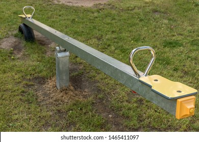 New seesaw on a children's playground with lawn