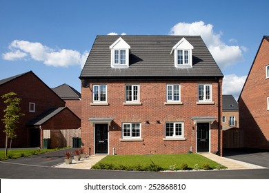New semi - detached house in sunny day