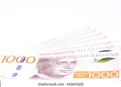 New series of one thousand swedish currency,money isolated on white background,Focus on eye of a man on banknotes