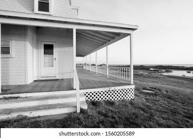 New Shoreham, Block Island, RI/USA- November 10, 2019: A horizontal black and white image of a wraparound porch and a pond in the distance.