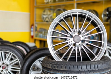 New silver mag wheel. Magnesium alloy car wheels and pneumatic tires in store or service center