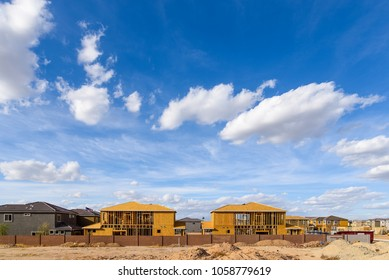 New single family residences being built in Phoenix, Arizona under a beautiful sky.