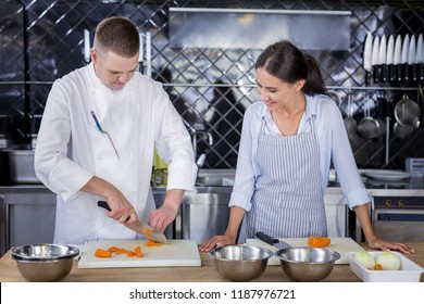 New skills. Smiling pretty lady being attentive while learning how to cook a dish