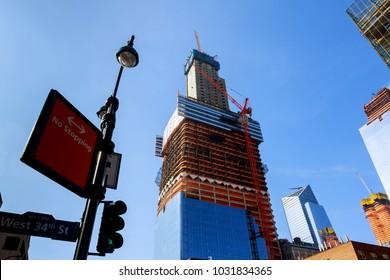 new skyscraper in New York, raising between old buildings,